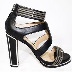 Gwen Stefani black and silver heels